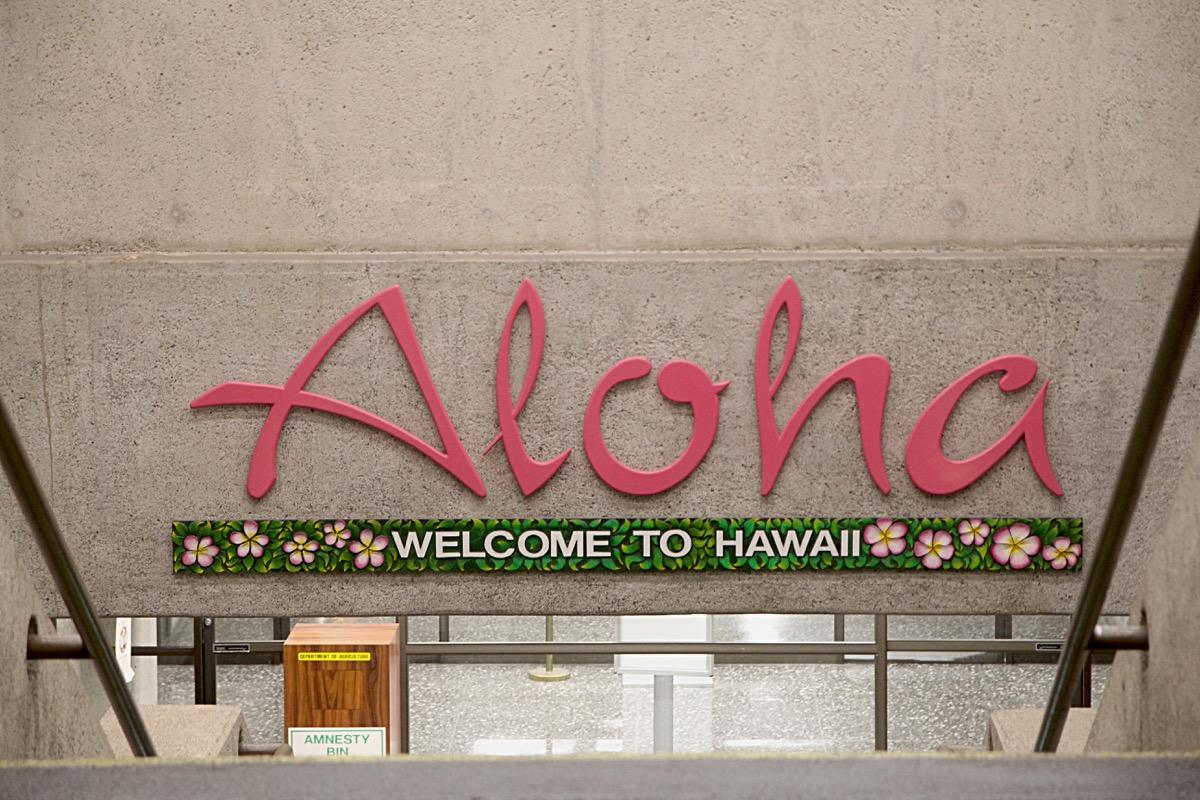 Hawaii sign welcoming visitors