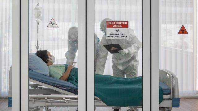 Woman in a hospital bed during coronavirus