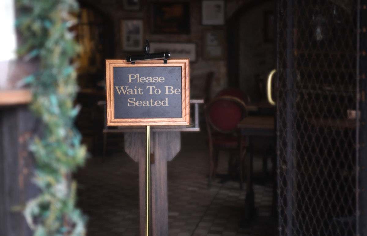 sign: please wait to be seated