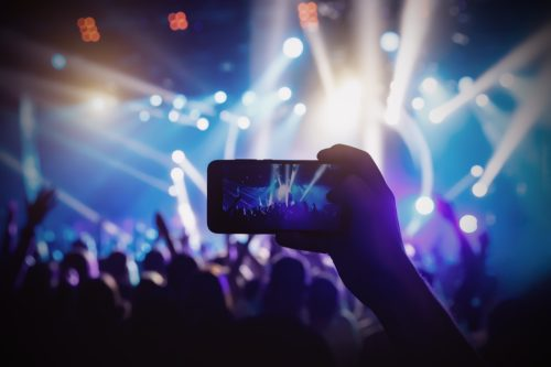 Photo for social networks at the concert, Mobile phone on music show