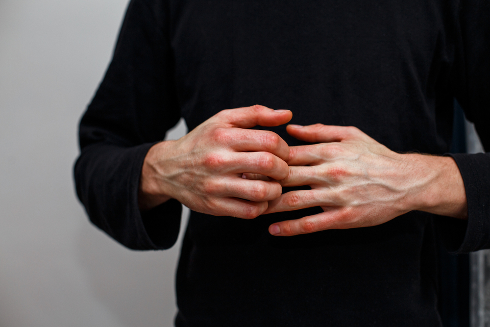 closeup of man itching hands