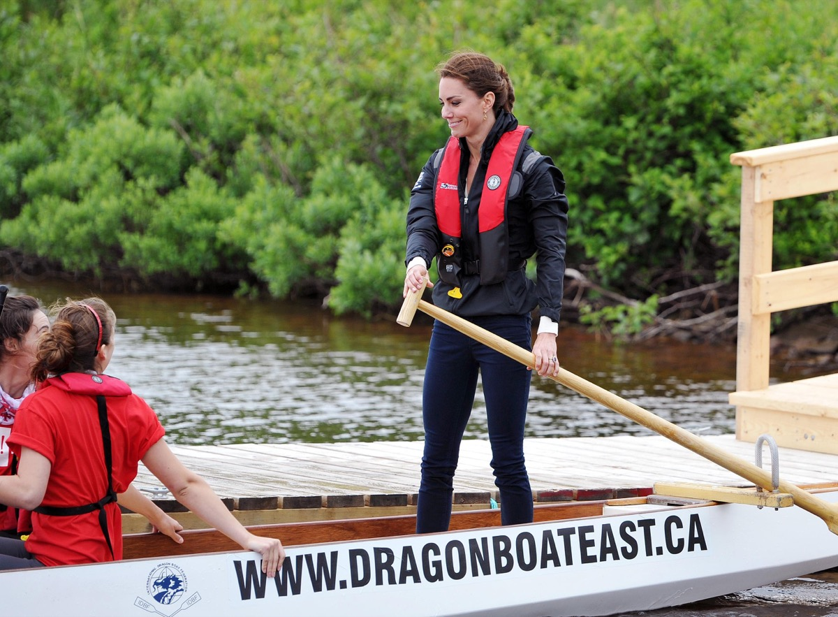 The Duchess of Cambridge steers a dragon boat before a race against her husband, across a lake in Dalvey by-the Sea, on Prince Edward Island in eastern Canada.