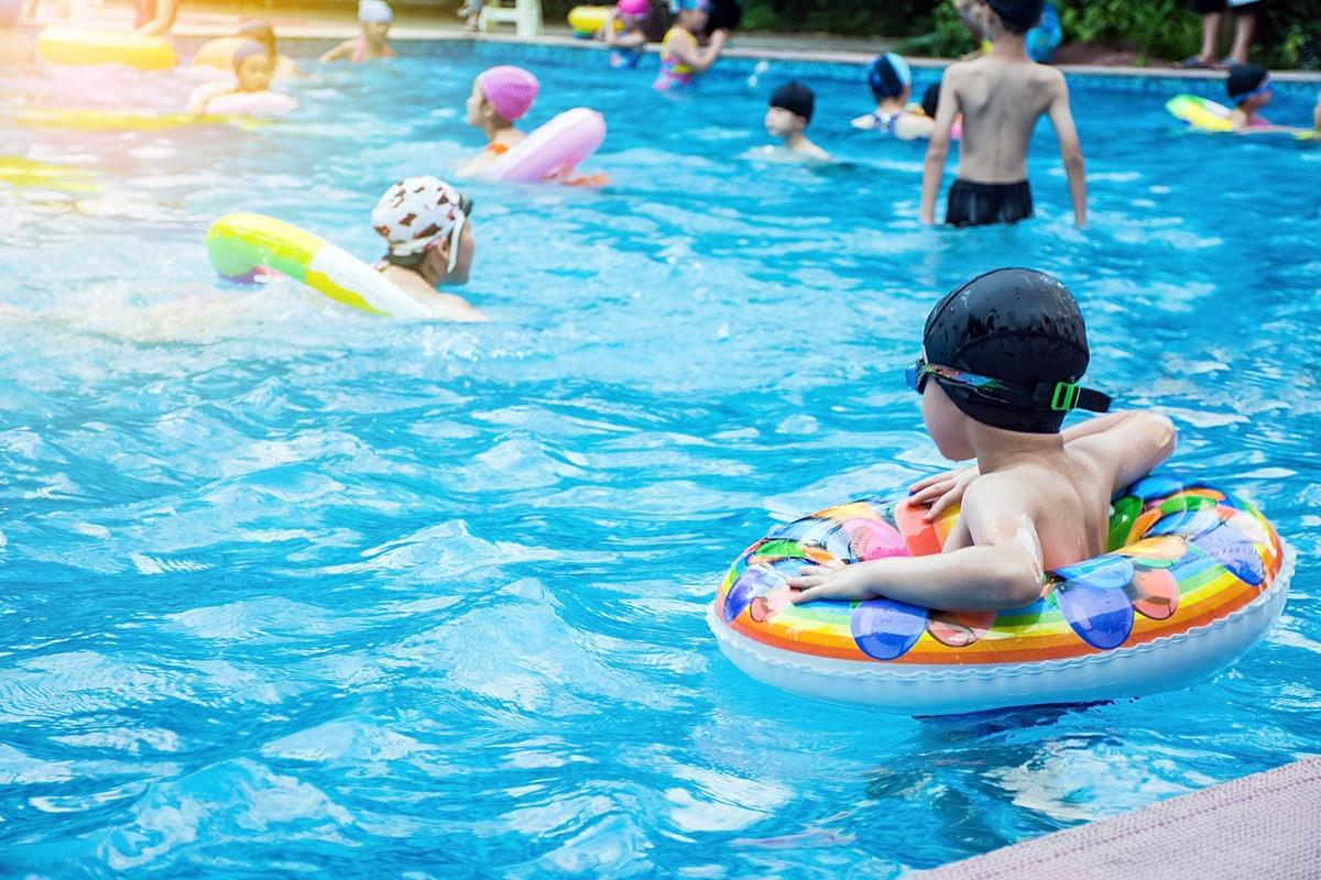 kids swimming in public pool