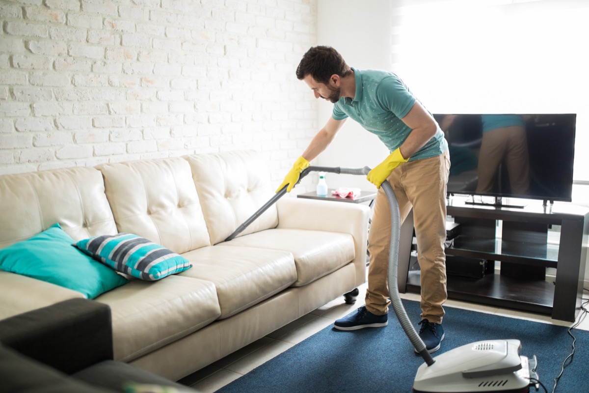 Man cleaning living room