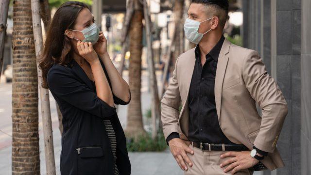 People talking wearing masks