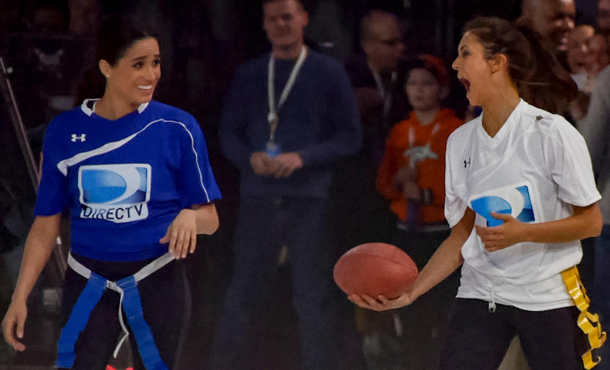Meghan Markle, left, with Nina Dobrev at Directv's 8th Annual Celebrity Beach Bowl on February 1, 2014 in New York, NY