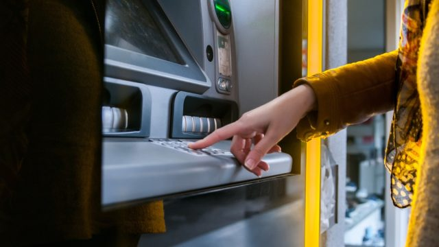 Woman getting money from atm