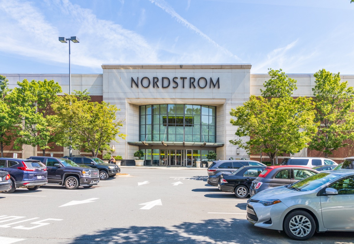 CHARLOTTE, NC, USA-28 July 19: Entrance to Nordstrom Department store, with crowded parking lot on a sunny summer day. (CHARLOTTE, NC, USA-28 July 19: Entrance to Nordstrom Department store, with crowded parking lot on a sunny summer day., ASCII, 119