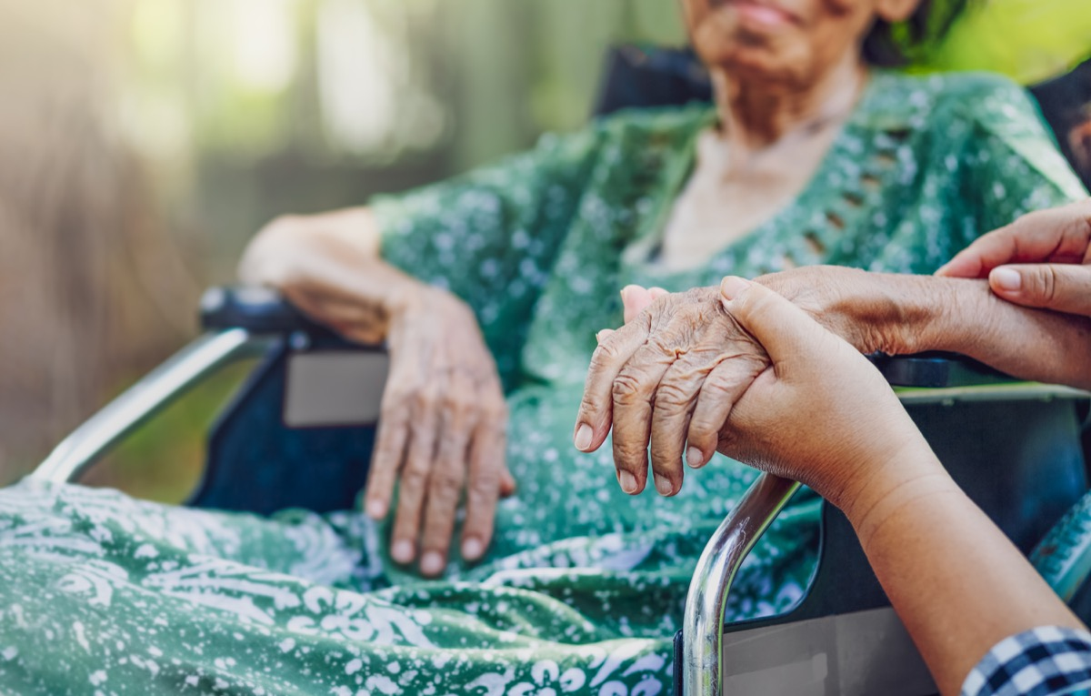 Elderly asian woman on wheelchair at home with daughter take care
