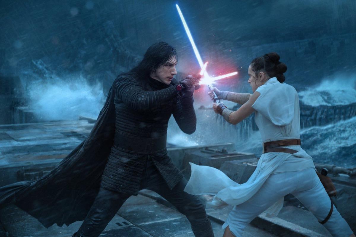 kylo ren and rey having a lightsaber battle in the rise of skywalker