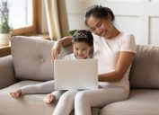 Parent and child on laptop