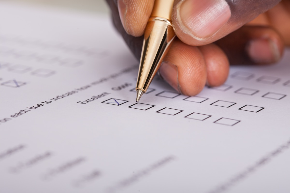 Patient filling out form with his own pen
