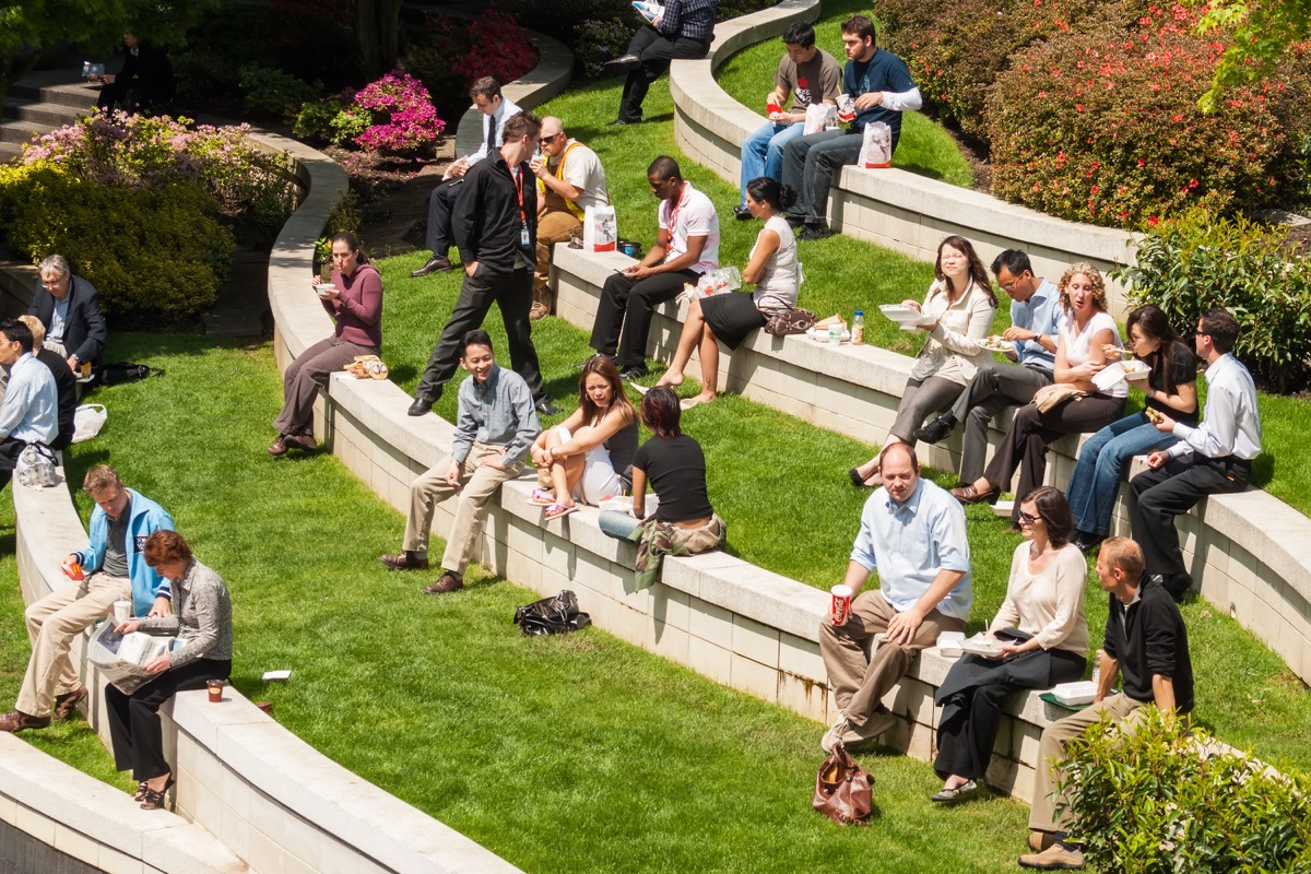 Groups of people sitting outside