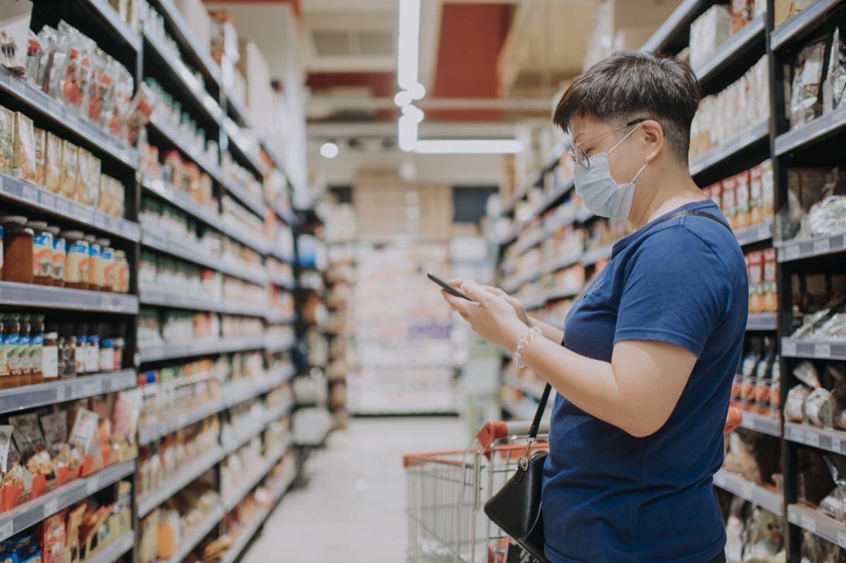female wearing a mask going out shopping in supermarket