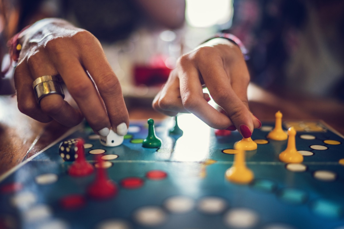 Close up of unrecognizable women playing board game.