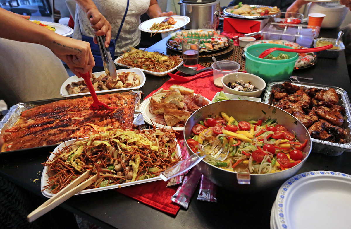 closeup of assortment of food at a potluck