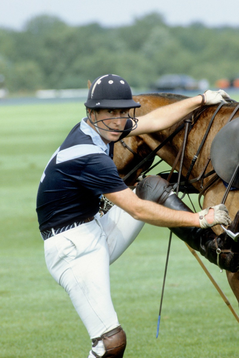 HRH Prince of Wales enjoys an afternoon playing polo at Guards polo club, Windsor, England.. Image shot 1984.