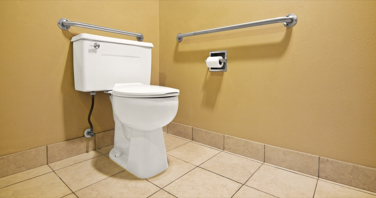 public restroom with toilet and safety bar