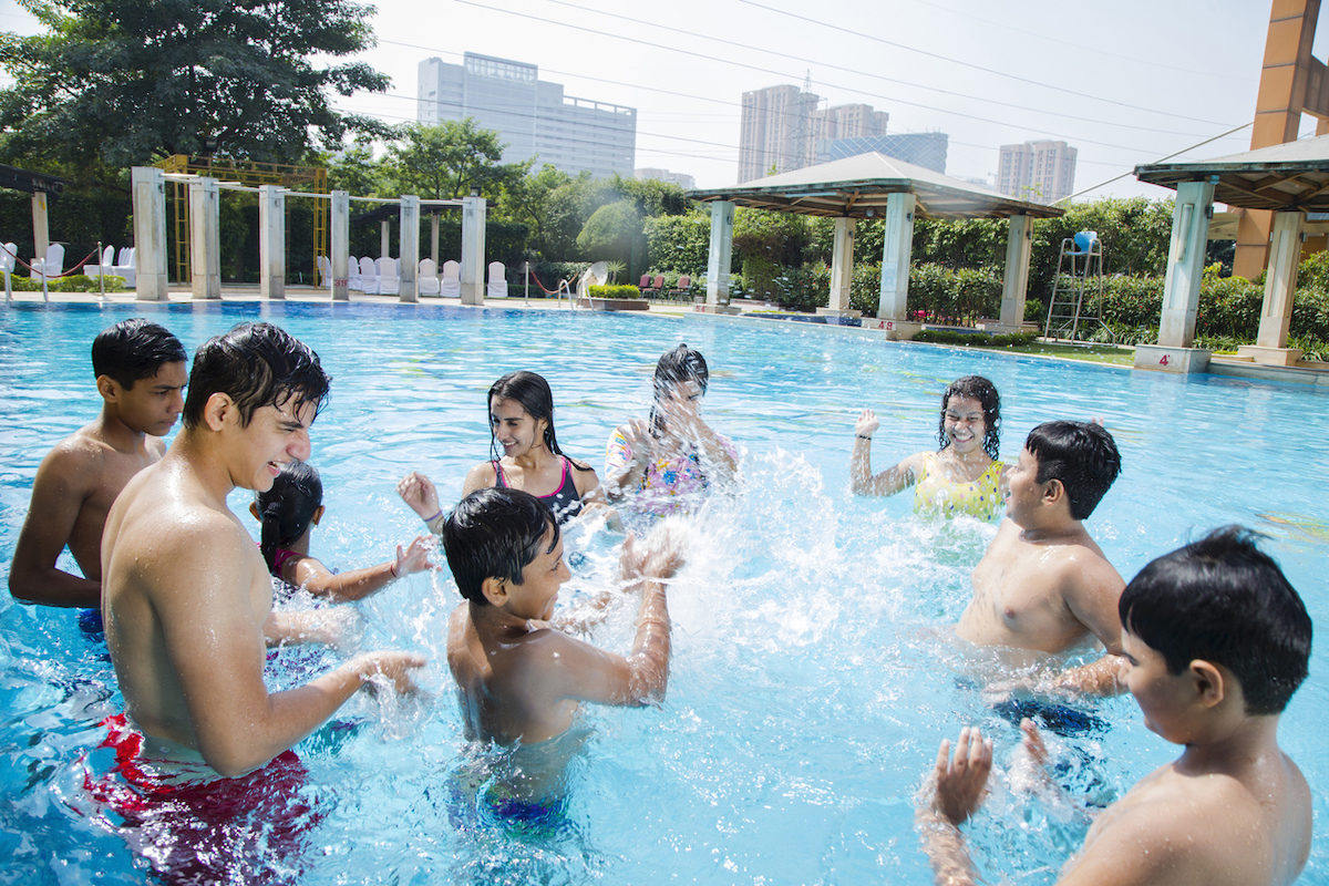 Multi-Ethnic group of teenagers in public swimming pool