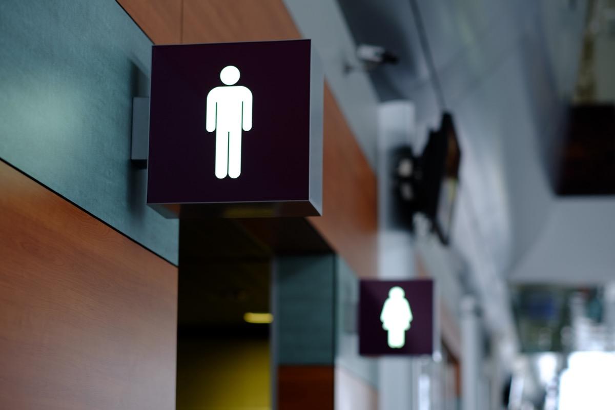 public bathroom sign shows outline of male figure