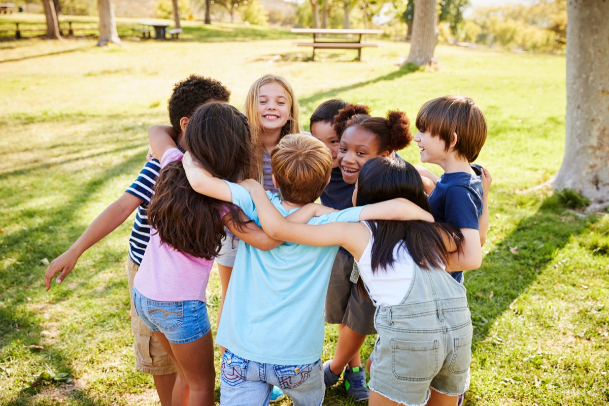 Kids in a huddle at recess playing contact sport
