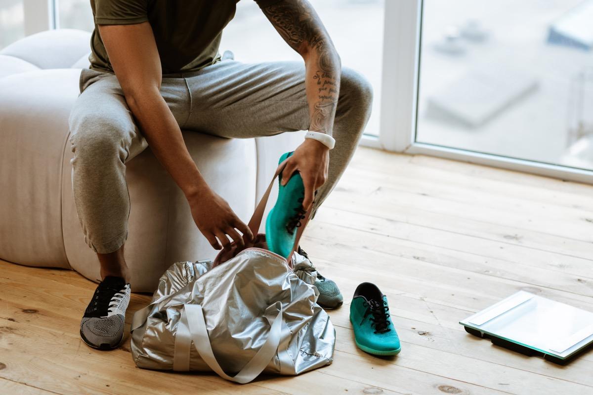 Man putting shoes away
