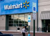walmart exterior with shoppers exiting into parking lot