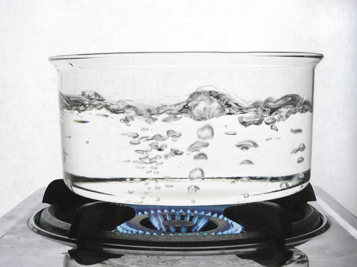 close up of boiling water in clear pan