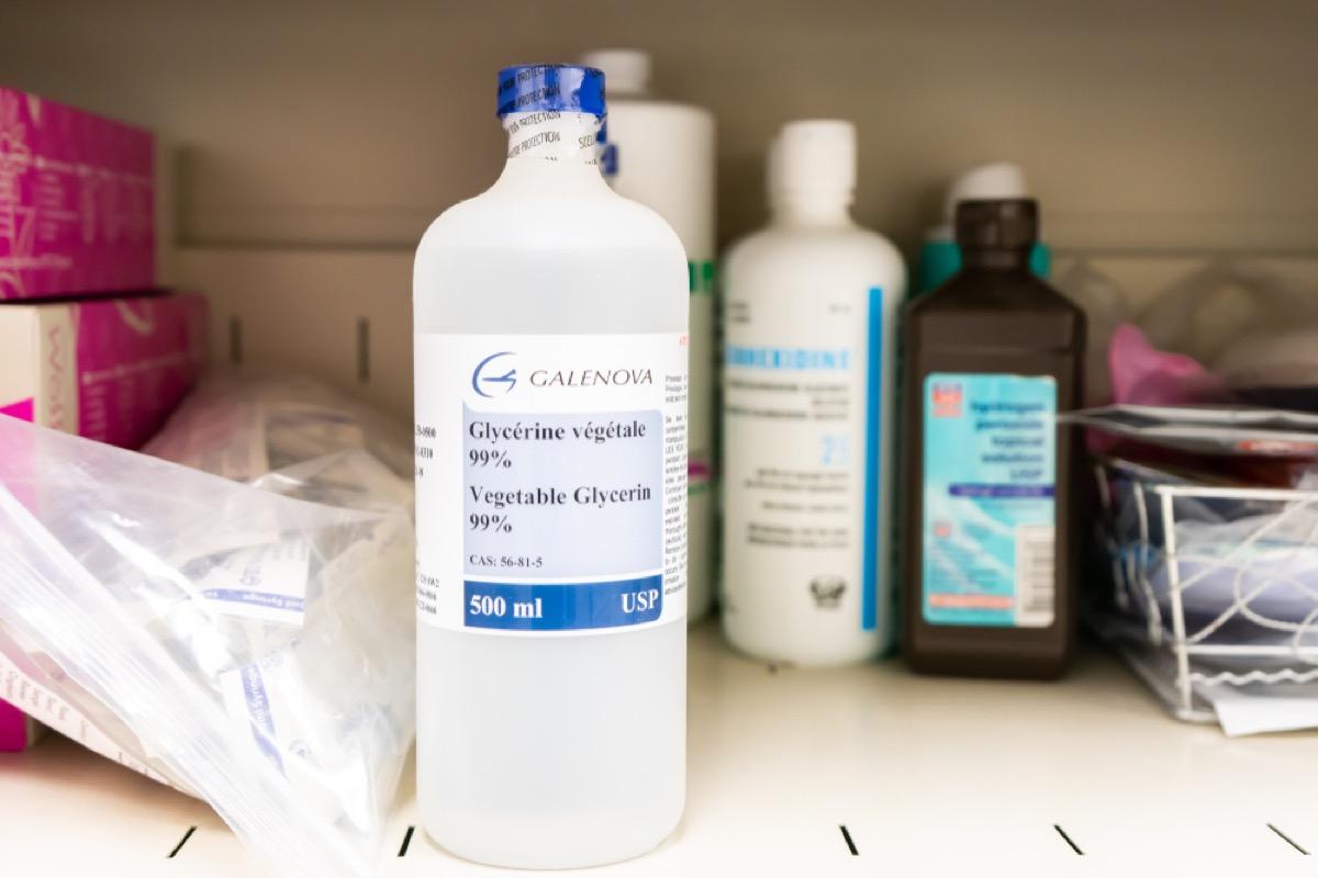 bottle of glycerine in front of other bottles