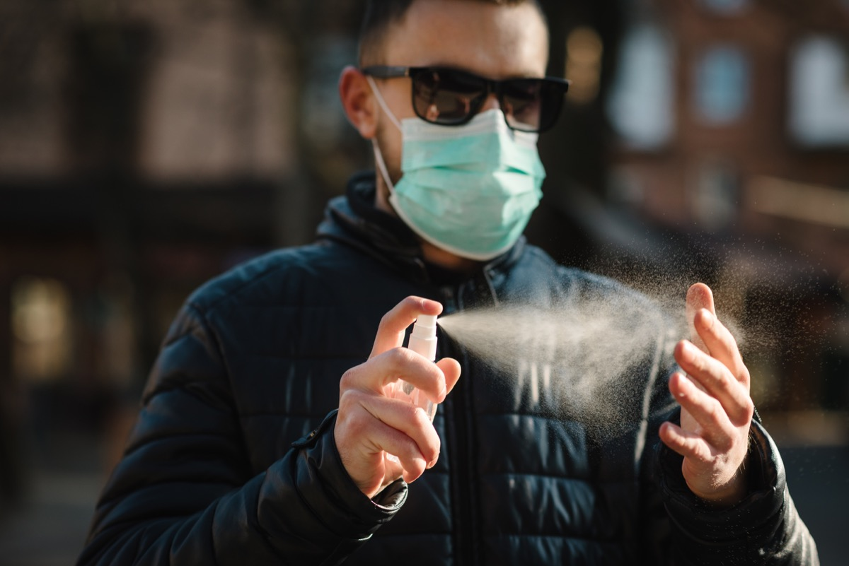 Man using sanitizing spray