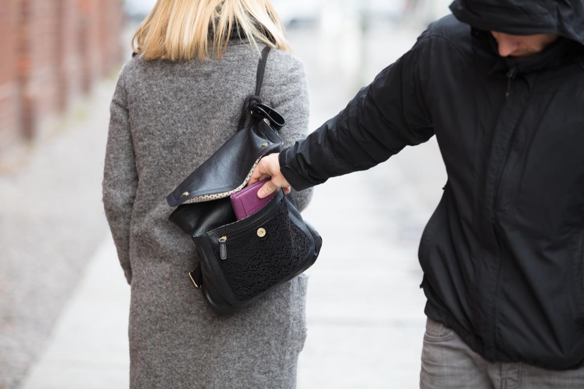 man stealing woman's wallet