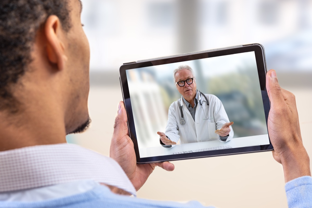 Man video chatting with doctor