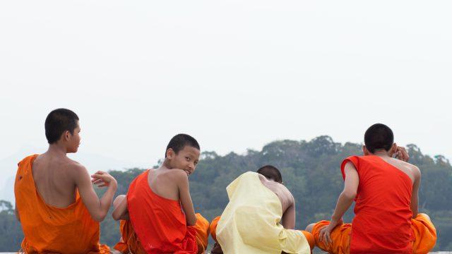 men sitting down from behind in thailand
