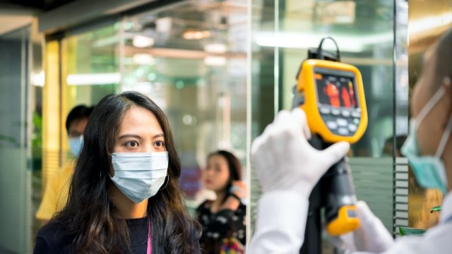 woman gets a thermal scan to check temperature for coronavirus