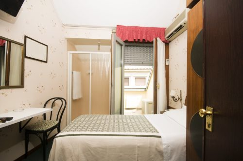 tiny hotel room with large bed
