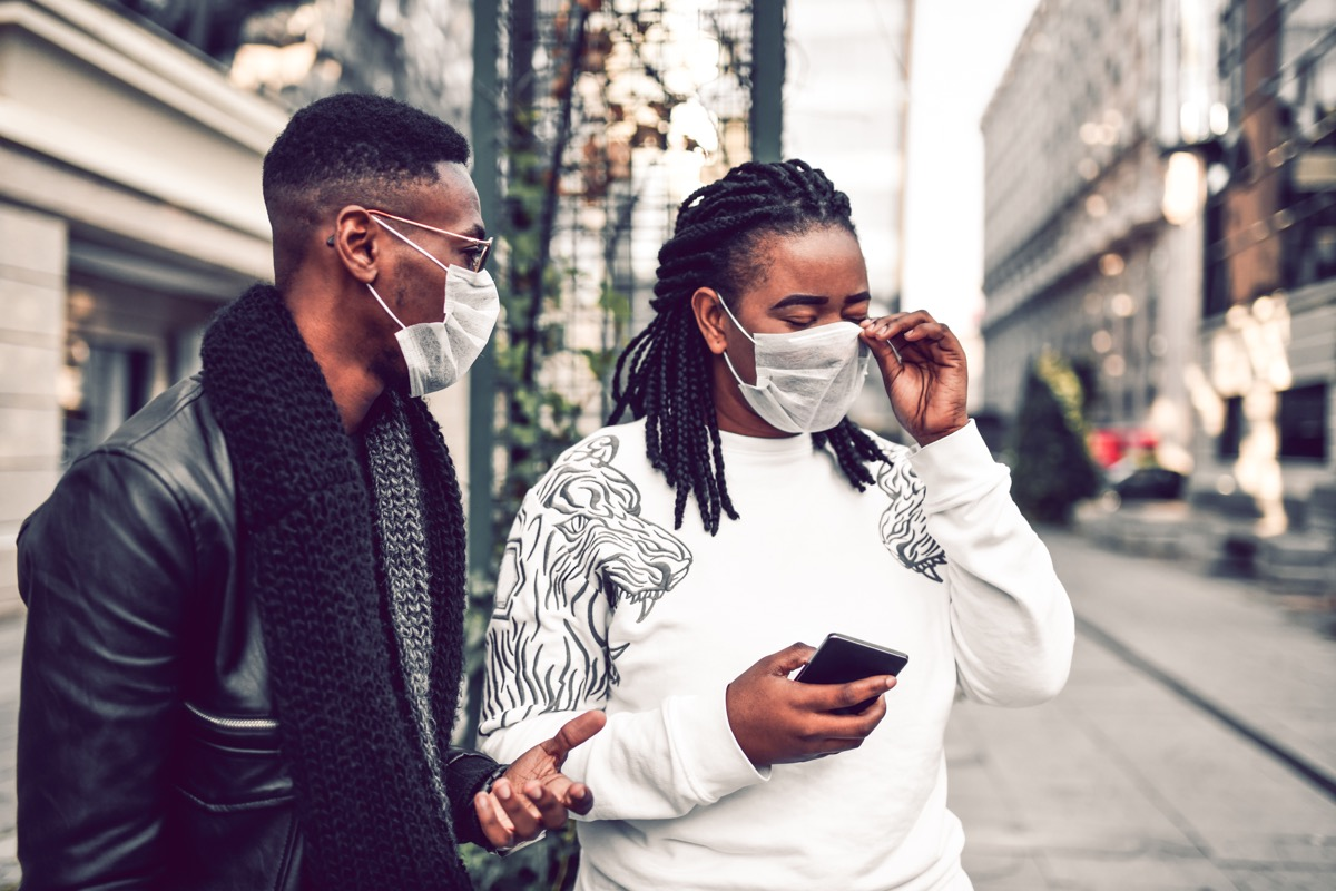 Couple Taking A Walk With Masks Because City Is Polluted