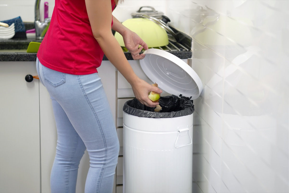 Woman throwing garbage out
