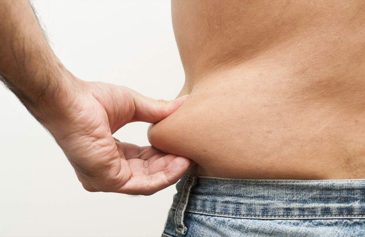 close up shot of men showing fat in his body.