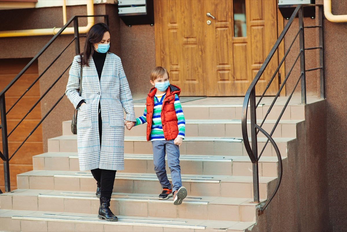Mother and son going for a walk with masks on