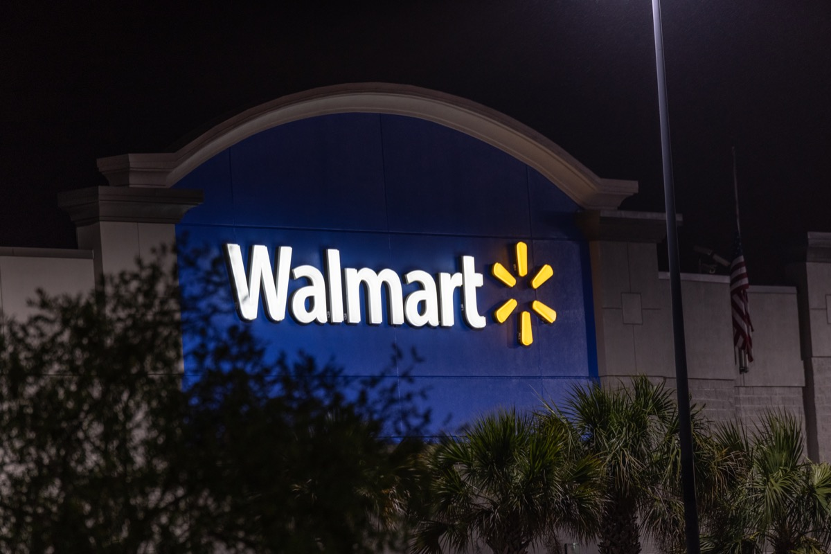 walmart sign on store exterior at night