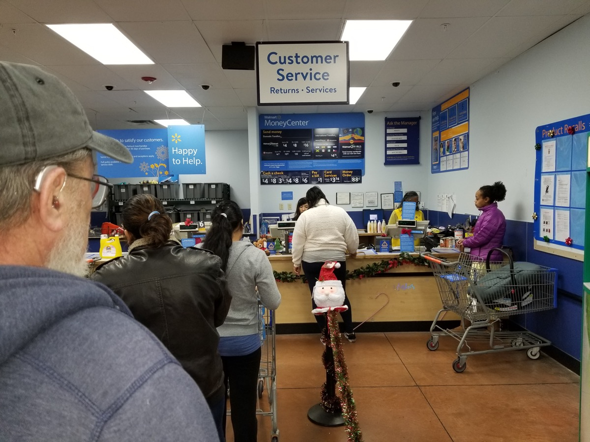 walmart customer service desk with long line