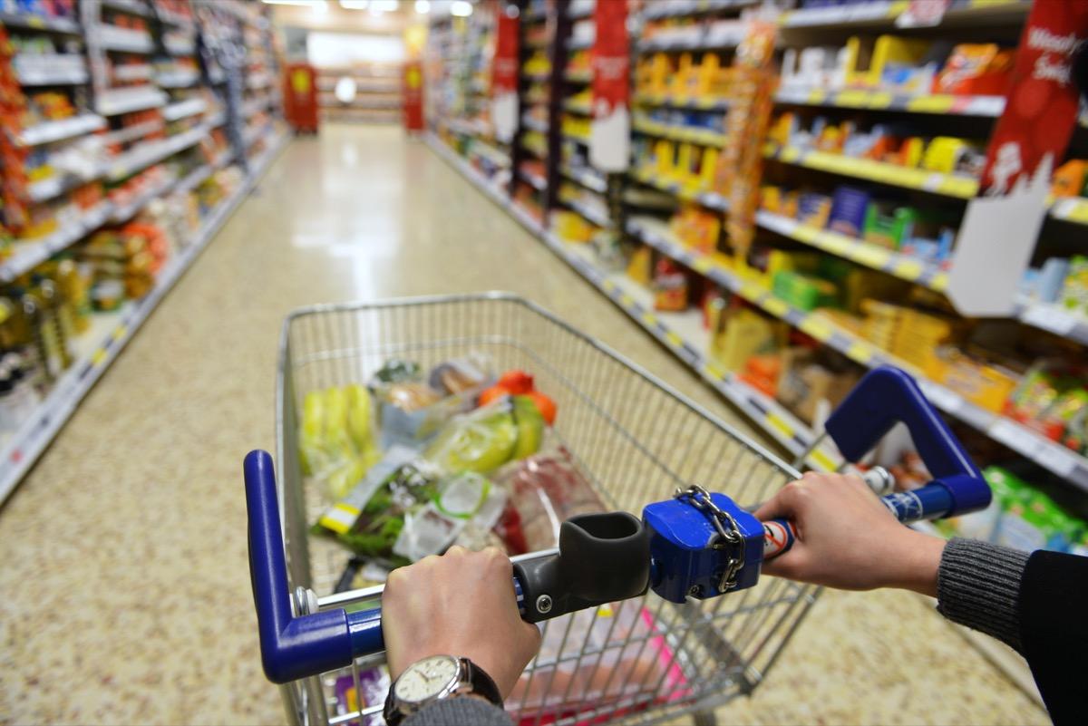 white hands pushing walmart shopping cart