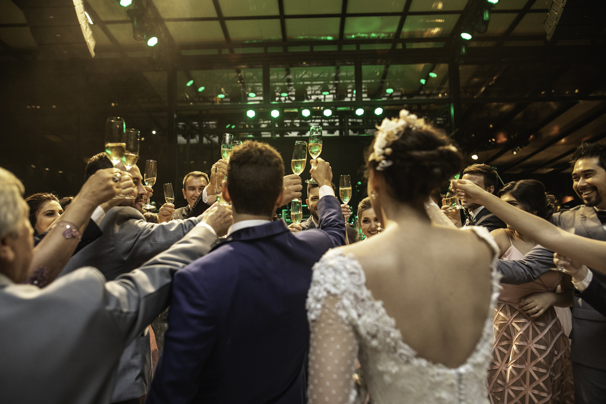 Bride, groom and wedding guests making a toast