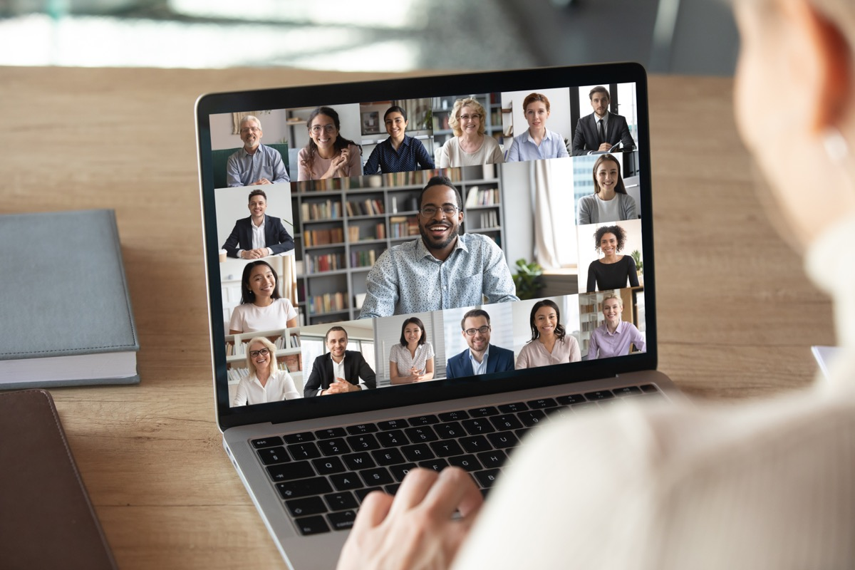 white woman sitting on laptop having zoom meeting or video call