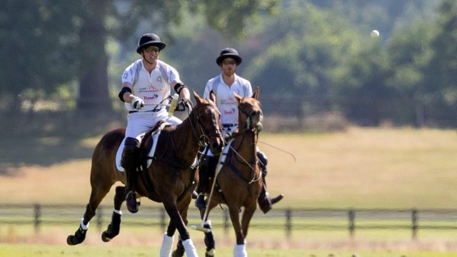 The Duke of Cambridge (left) and the Duke of Sussex playing polo at Coworth Park, Ascot.