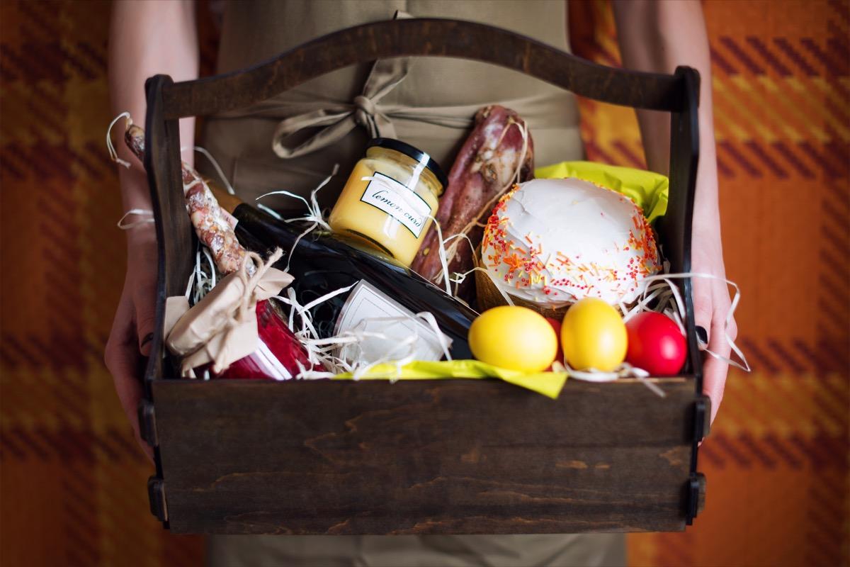 white woman holding gift basket