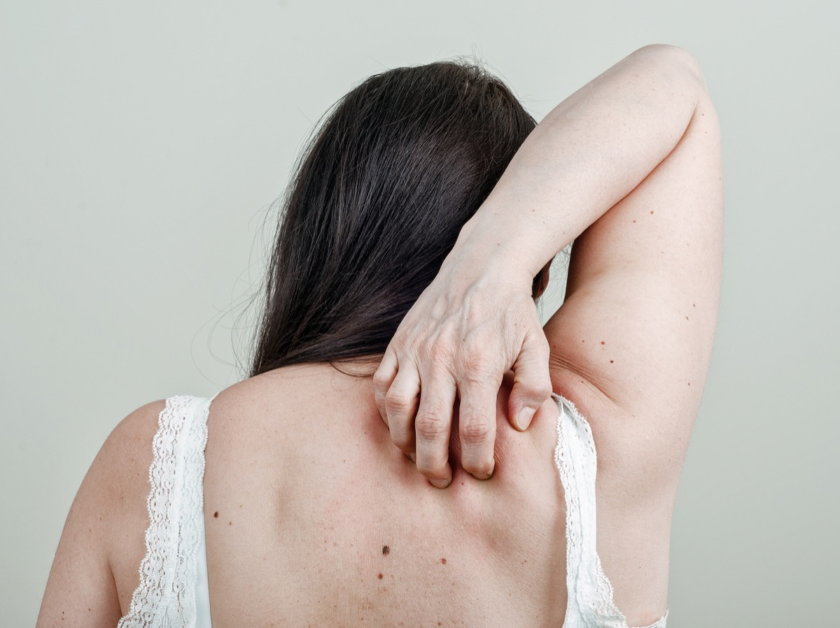 woman scratching her back