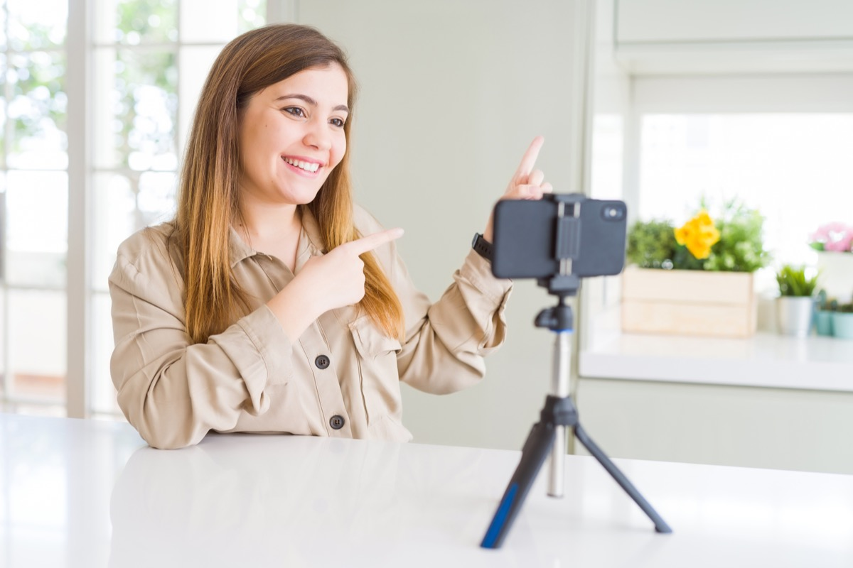 young woman on video call on iphone