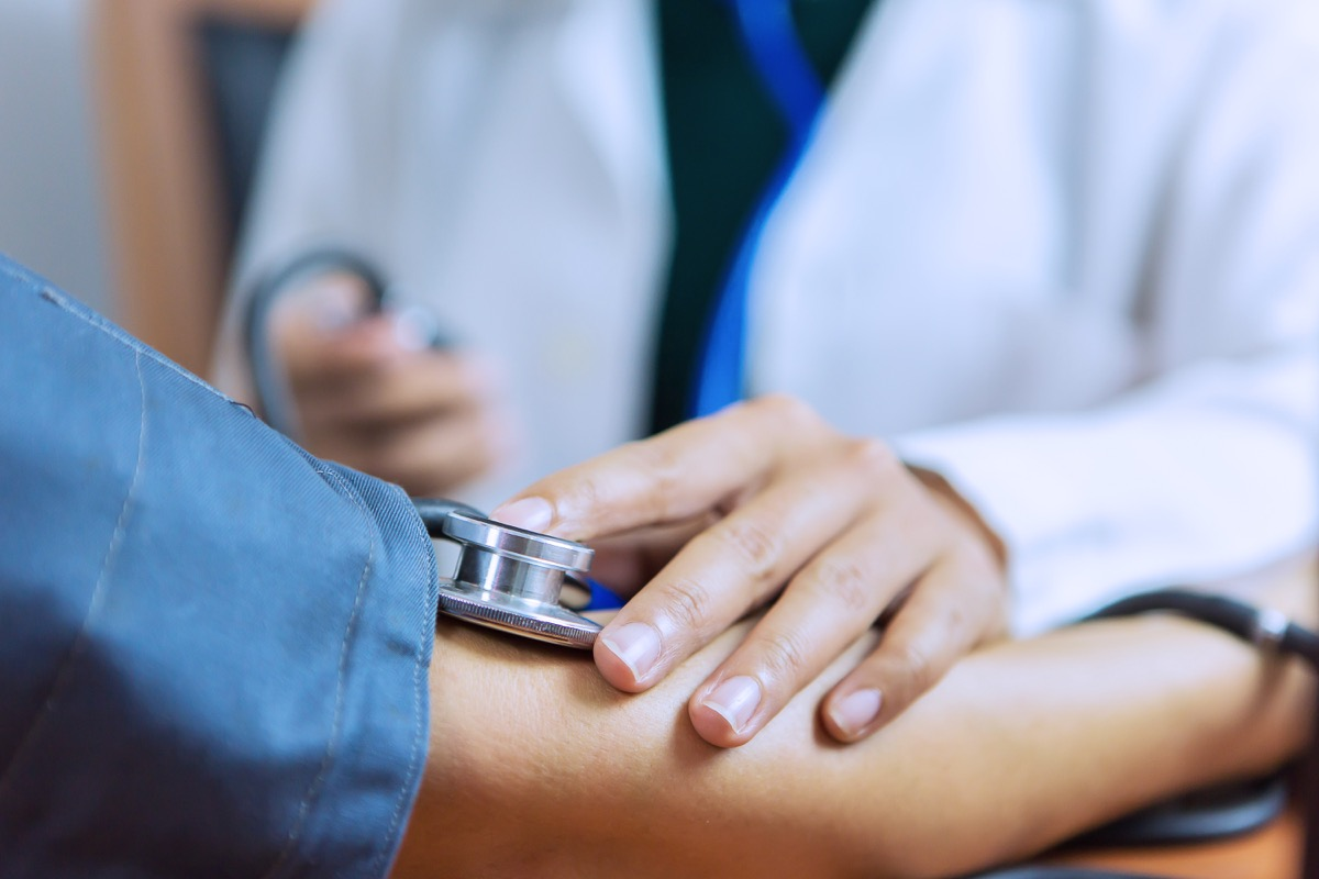 closeup of Dr. taking blood pressure