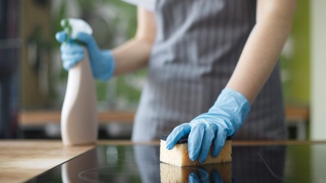 Woman cleaning with gloves